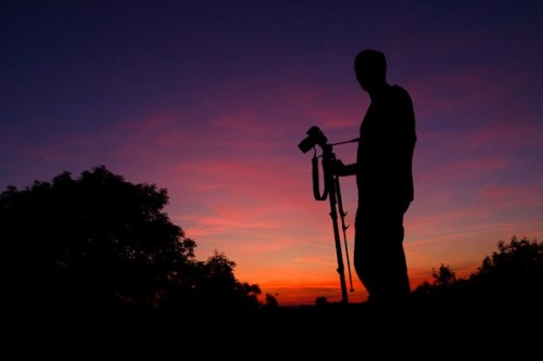 Another silhouette of Graham with his camera.