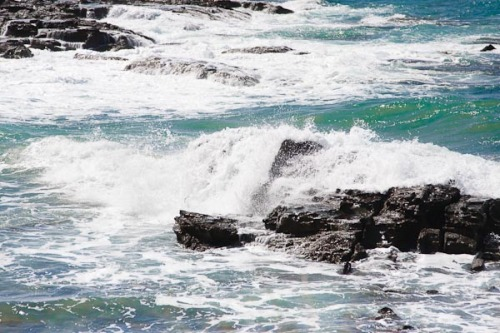 The sea washing over rocks.